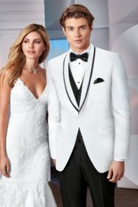 Model showcasing white prom tuxedo