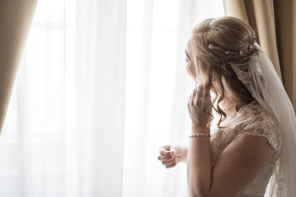 Bride fixing hair