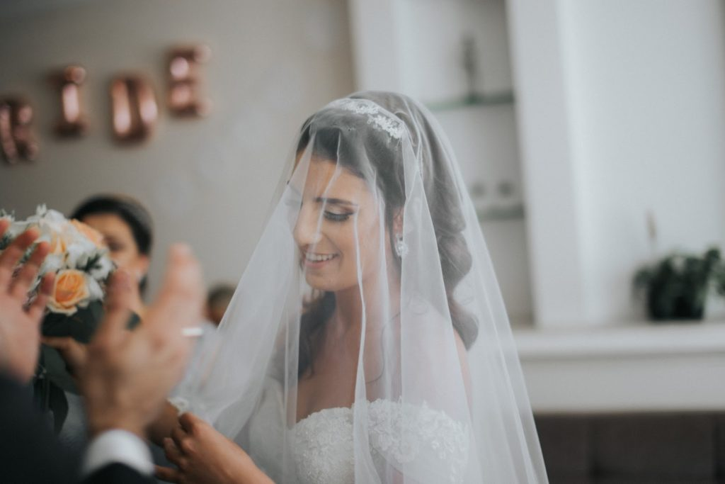Bride with veil draped over face