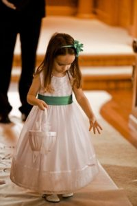 Flower girl throwing petals down the isle