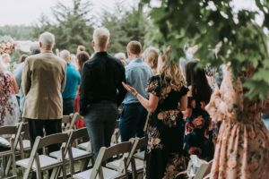 Guests standing at wedding