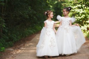 two happy beautiful girls with white wedding dresses