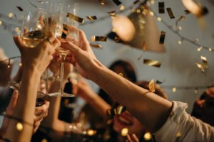 Friends toasting champagne at wedding